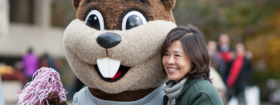 a parent posing with tim the beaver