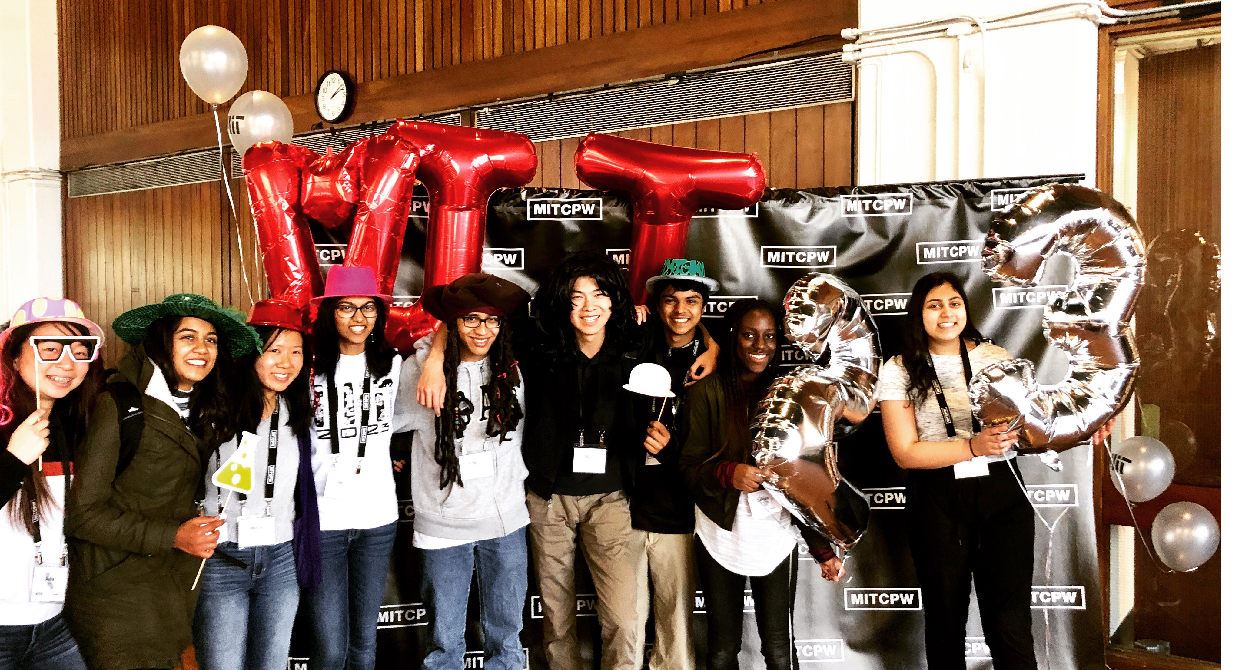 A group of students posing in front of a CPW 2019 banner