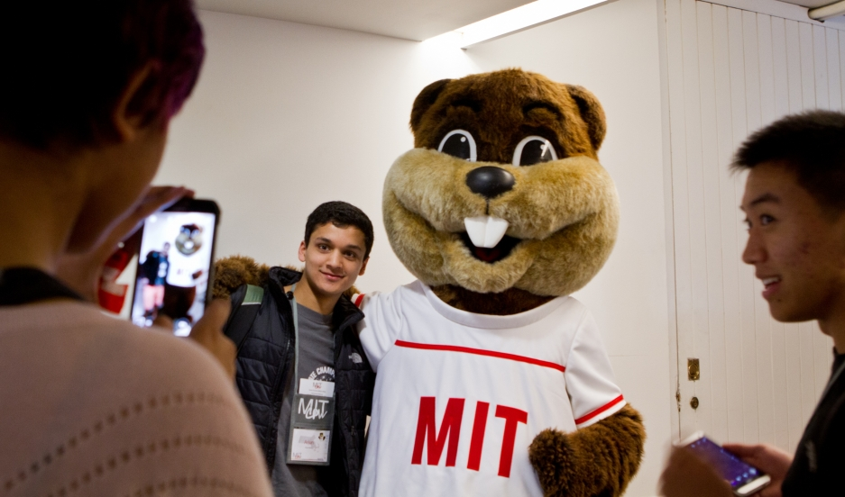 tim the beaver posing with students