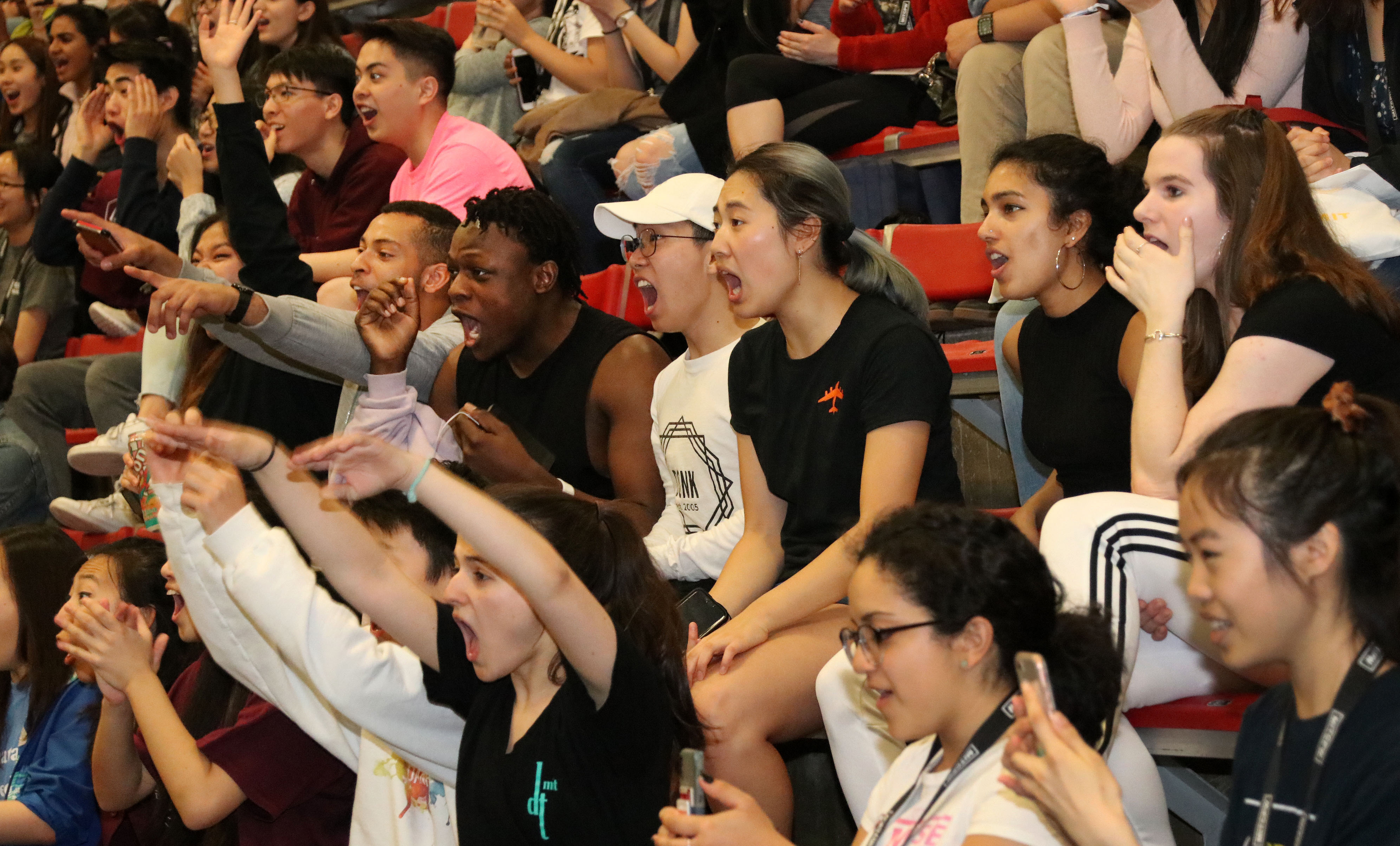 Students cheer at a dance performance