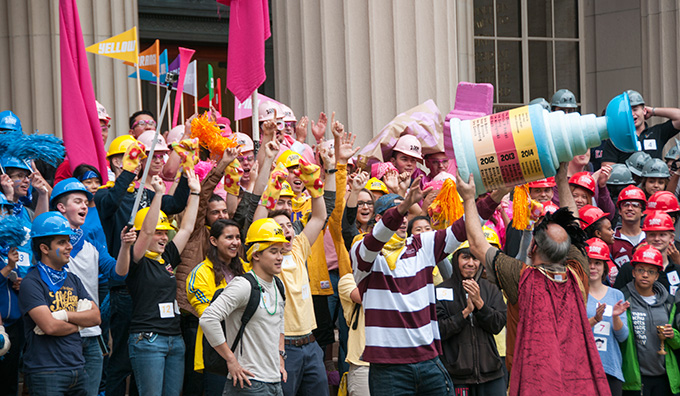 students cheering while dressed up in colorful costumes